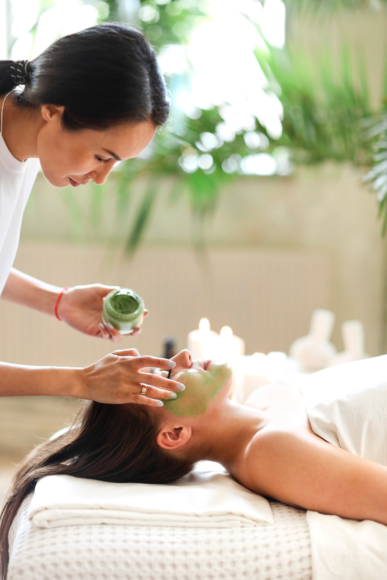 beautiful-relaxed-woman-having-green-clay-face-mask-in-spa-salon.jpg